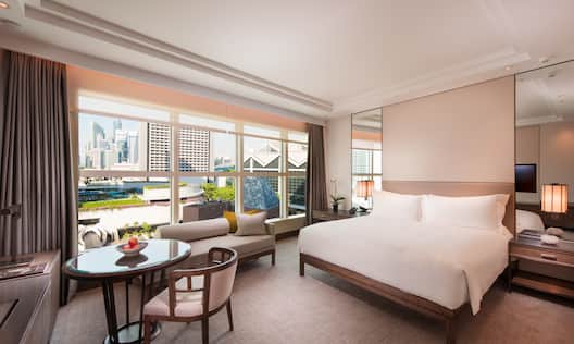 One King Bed Guest Bedroom with Table, Chair and Outside View