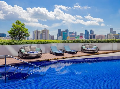 Outdoor Pool, Seating, and View of City Skyline