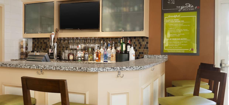 Counter Seating and TV at Fully Stocked Bar