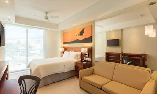 One King Bed Guest Bedroom with Sofa, Work Desk and Wall Mounted TV