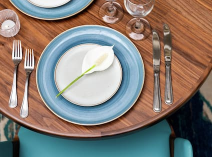 Beautiful dining table with lily of the valley.