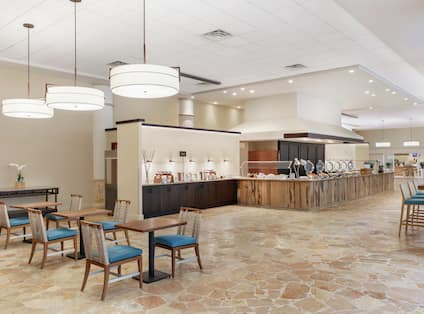 Spacious breakfast area featuring complimentary buffet and ample seating.