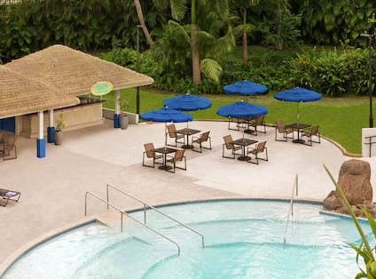 El Coqui outdoor pool bar featuring spacious patio and pool.