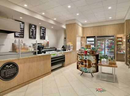 Convenient on-site coffee shop featuring beverages, made to order food, and easy grab and go snacks.