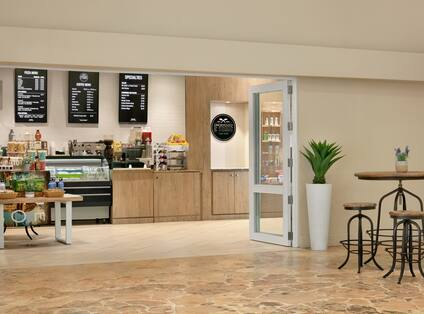 Convenient on-site coffee shop featuring beverages and grab and go food.