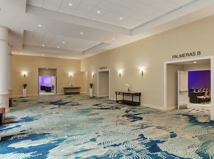 Spacious pre function area outside of Palmeras ballroom.
