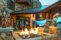 Couple Standing by Outdoor Firepit