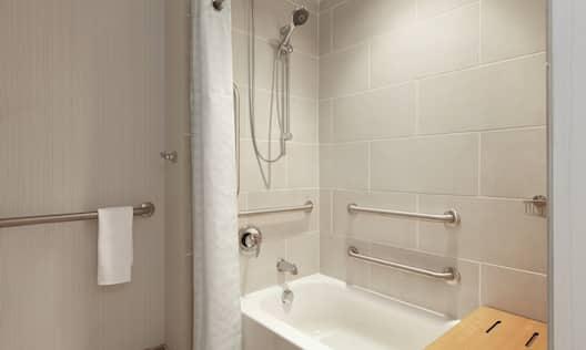 ADA Bathroom with Tub Grab Bars and Seat