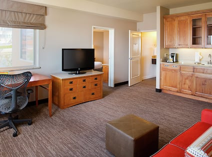 Guest Suite Living Room with Sofa, Work Desk, Television and Kitchenette
