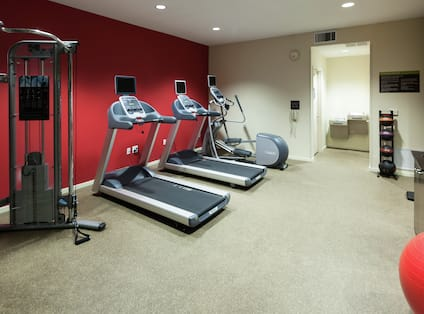 24-Hour Fitness Room with Weights and Cardio Equipment