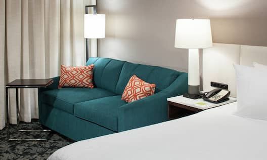 King Room Lounge Area with Sofa-Bed