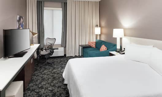 Guest Room with King Bed, Sofa Bed, Work Desk and HDTV