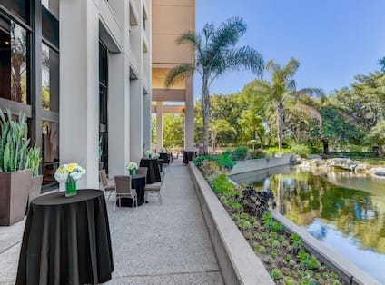 Reception Tables Overlooking Water from Atrium Patio