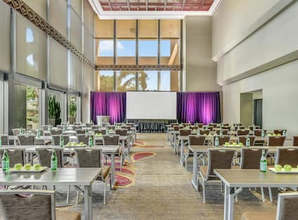DoubleTree Hotel Atrium with Tables, Chairs, and Outside View