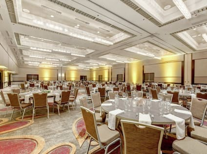 DoubleTree Hotel Ballroom with Round Tables and Chairs