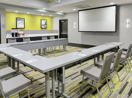 Meeting and Event Space with Tables Setup in U-Shape