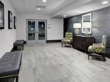 Entrance Foyer with Leather Benches and Chairs