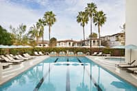 Pool and sun loungers at Waldorf Astoria Monarch Beach