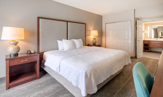 Guest Room with Large Bed and View of Vanity Area