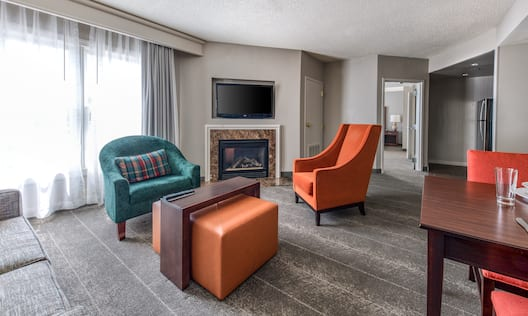 Suite Living Room Area with HDTV and Fireplace