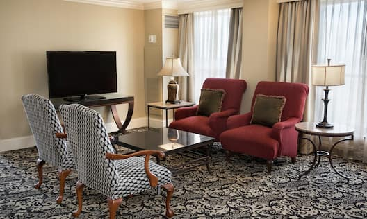 Guest Suite Living Room with Armchairs Table and TV
