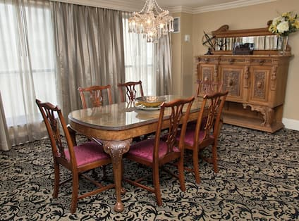Guest Suite Dining Room Area with Large Table and 6 Chairs