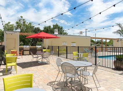 Outdoor Patio And Grills Near Pool