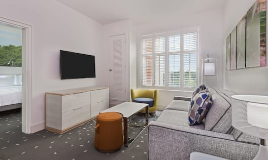 Seating Area, TV and View of Bedroom with Queen Bed