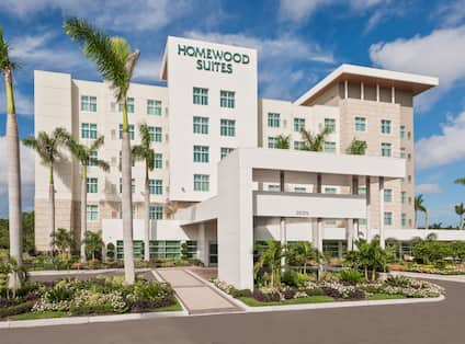Front of Hotel Exterior, Signage, Landscaping, and Circle Drive in Daytime