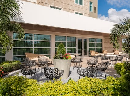 Outdoor Area with tables, chairs and shrubbery