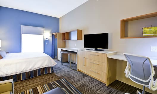 Room with King Bed, TV, and Work Desk