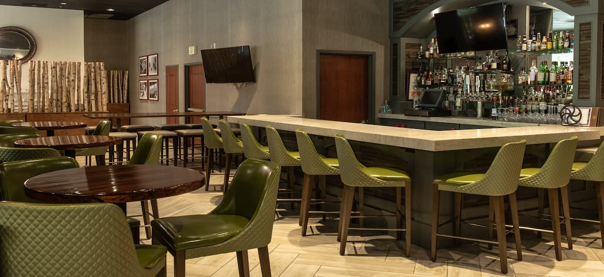 Bar area with tables and chairs