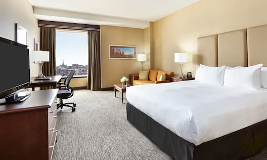 One king bed with city views of Saint John.