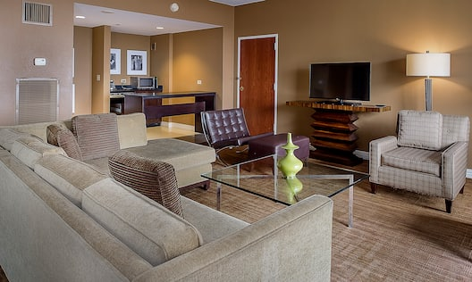 Presidential Suite Living Room with Couch, Chairs, Television and Kitchen Area