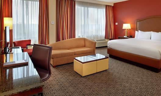 King Junior Suite with Bed, Lounge Area, Work Desk, and Room Technology