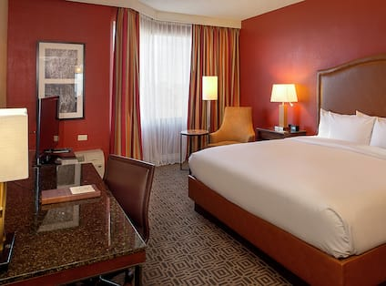 King Deluxe Guestroom with Bed, Lounge Area, Room Technology, and Work Desk