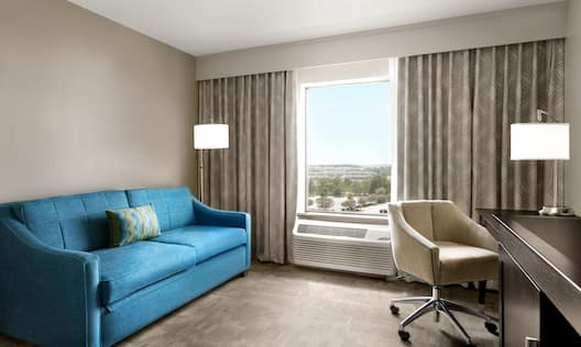 Guestroom Lounge Area with Sofa, Outside View and Work Desk