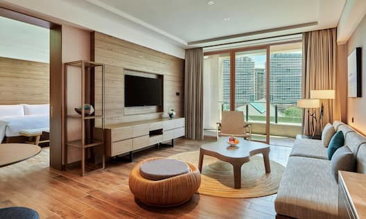 a suite living room seating area, tv and a balcony