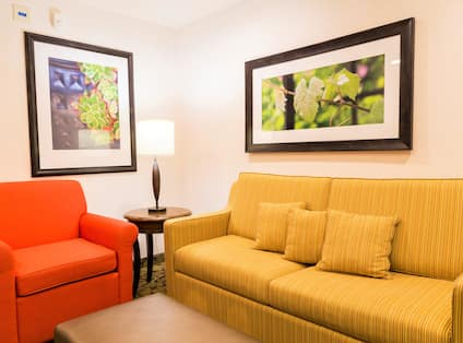 Guest Suite Living Room with Sofa, Armchair and Footrest