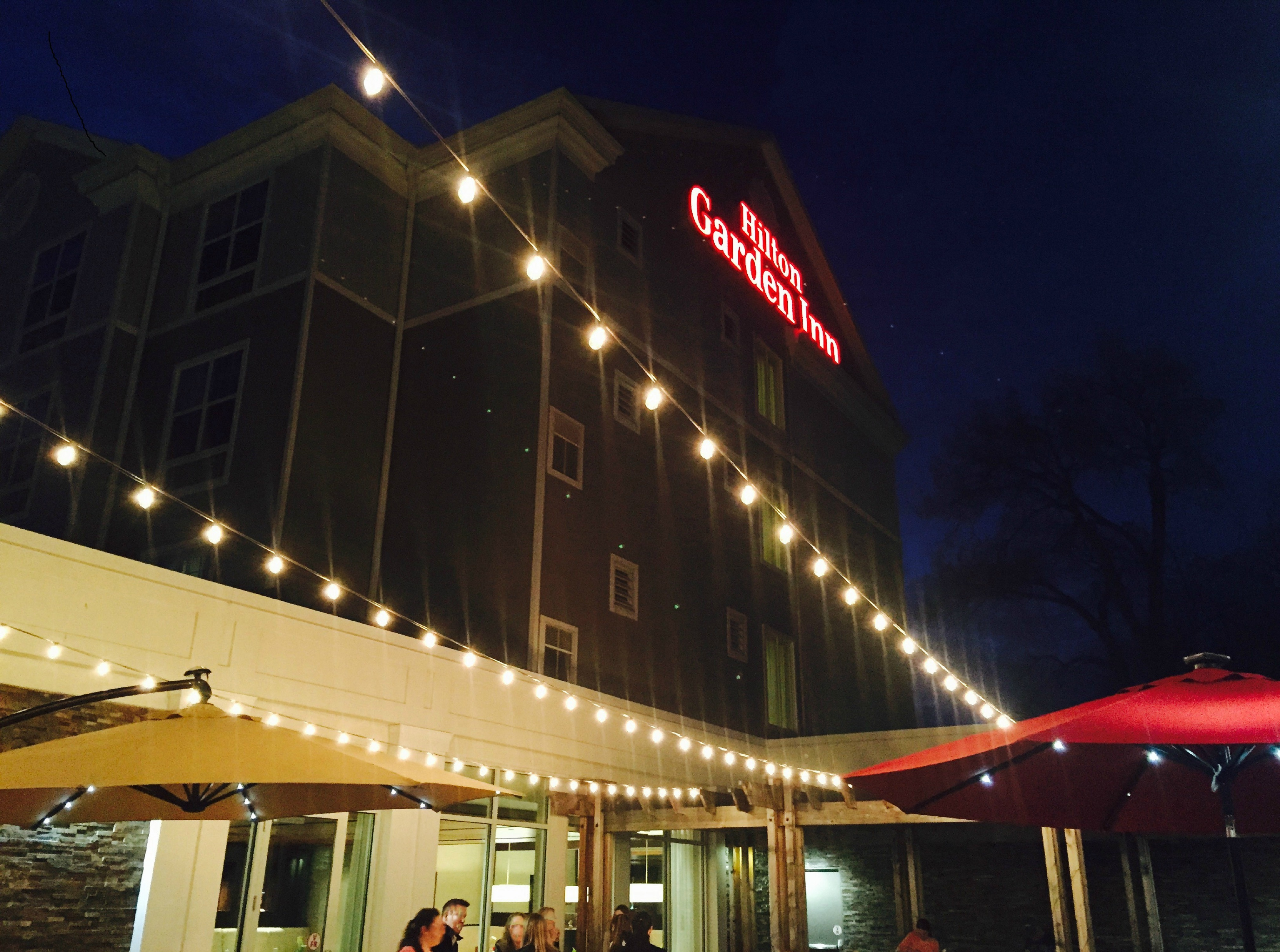 Outdoor Patio and Hotel Building Exterior at Night