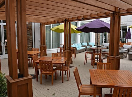 Outdoor Patio Seating Area with Chairs and Tables