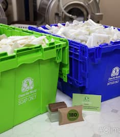 Recycling bins overflowing with bars of soap to be recycled and reused through Hilton's Clean the World program.