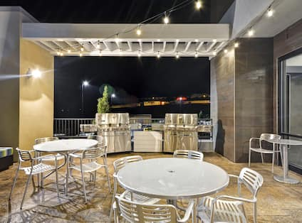 Outdoor Patio with Gas Grills, Tables and Chairs