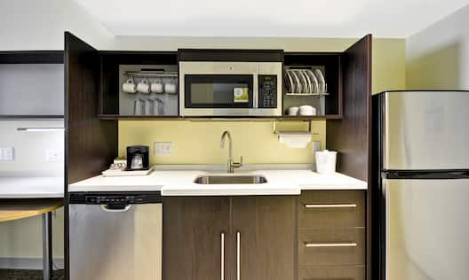 Studio Suite Kitchen with Fridge, Dishwasher, Sink and Microwave