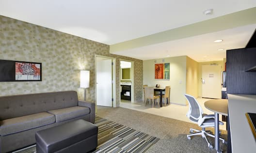 Suite Living Area with Sofa, Desk and HDTV