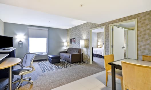 Suite Living and Dining Area with Work Desk, HDTV and Sofa