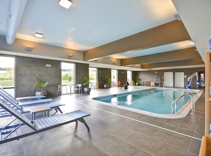 Indoor Swimming Pool and Lounge Chairs