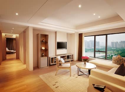 Guest Suite Living Room with Sofa, Coffee Table, Armchair and Wall Mounted HDTV