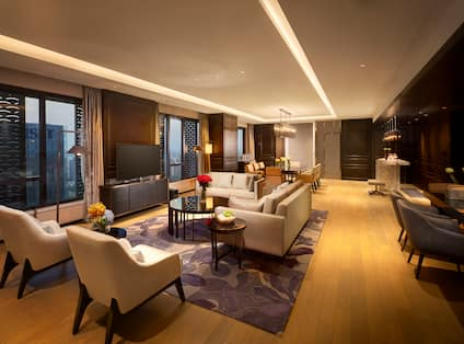 Presidential Suite Living Room with Sofas, Armchairs, Coffee Table and HDTV