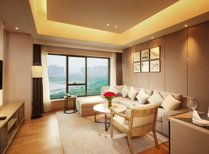 Guest Suite Living Room with Sofa, Armchair, Coffee Table and Wall Mounted HDTV